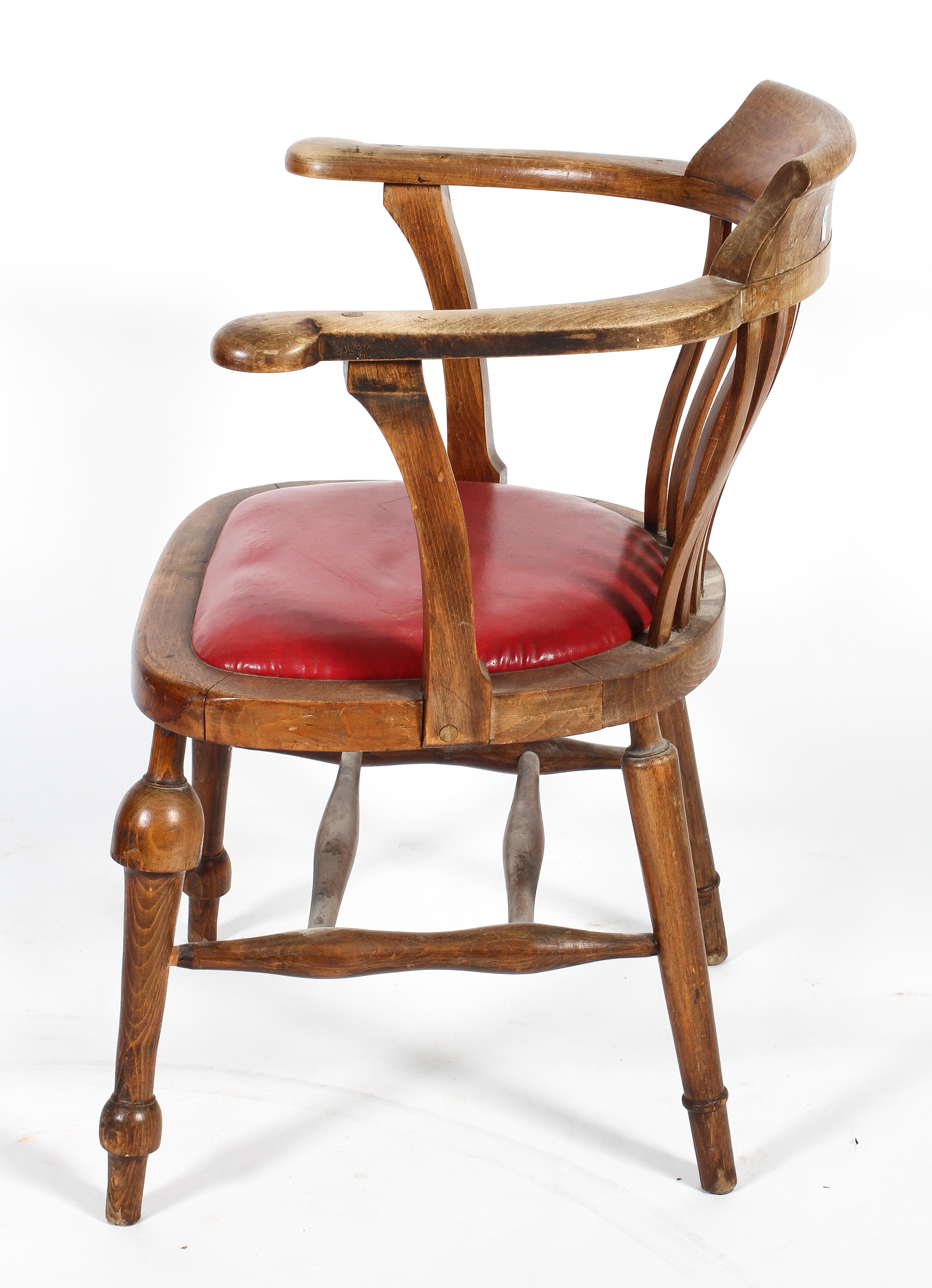 An Edwardian elm desk chair, with lathe back and padded seat, - Image 2 of 2