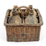 A set of four 19th century stoneware liqueur flasks, including brandy and Irish whisky,