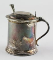 An Elizabeth II silver mustard pot, of cylindrical form with blue glass liner,