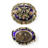 A collection of two yellow metal Victorian mourning brooches having ornate designs.