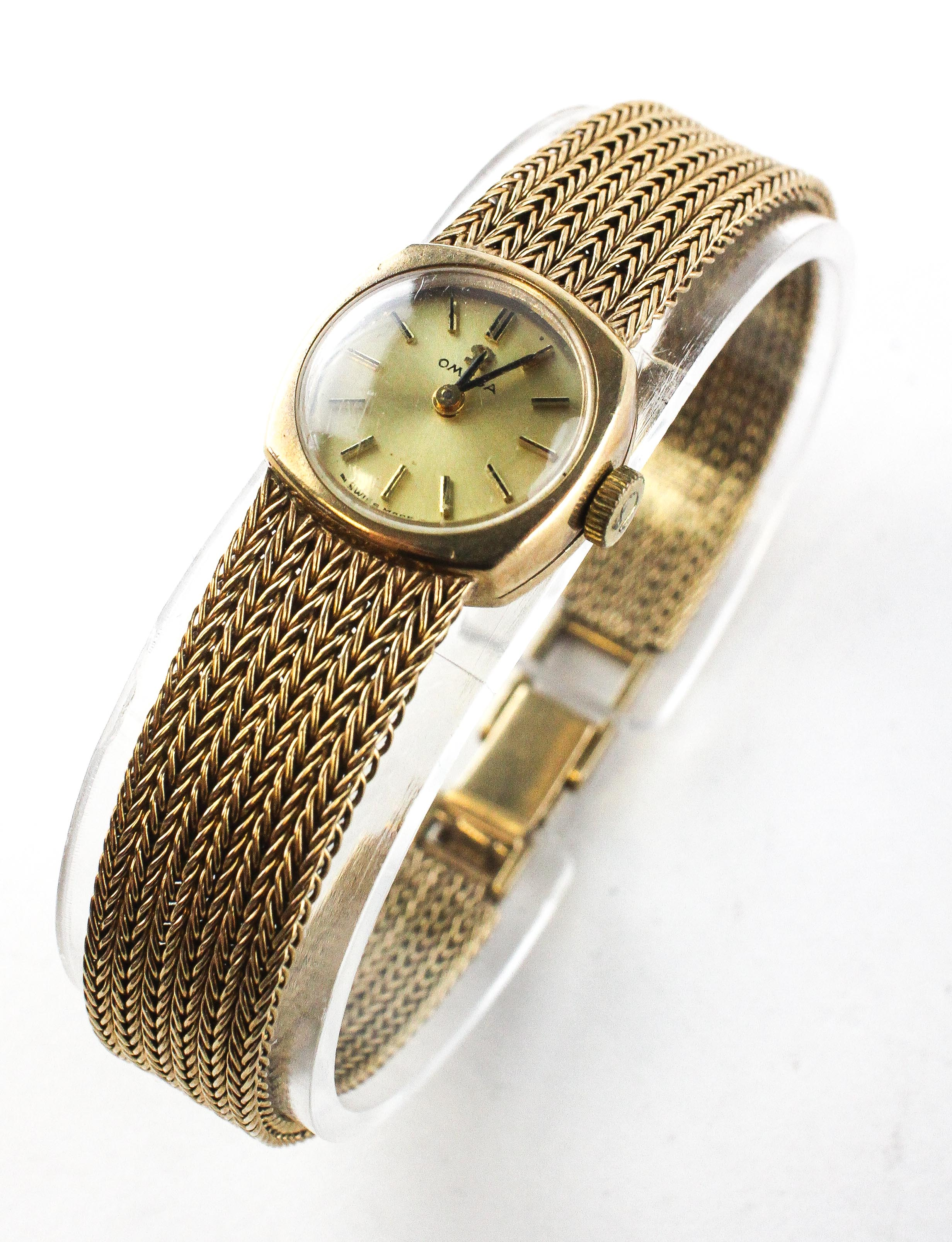 A yellow gold omega wristwatch. Circular gold dial with baton markings. - Image 2 of 4