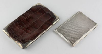 A George V silver mounted crocodile skin purse, hallmarked for London 1910,