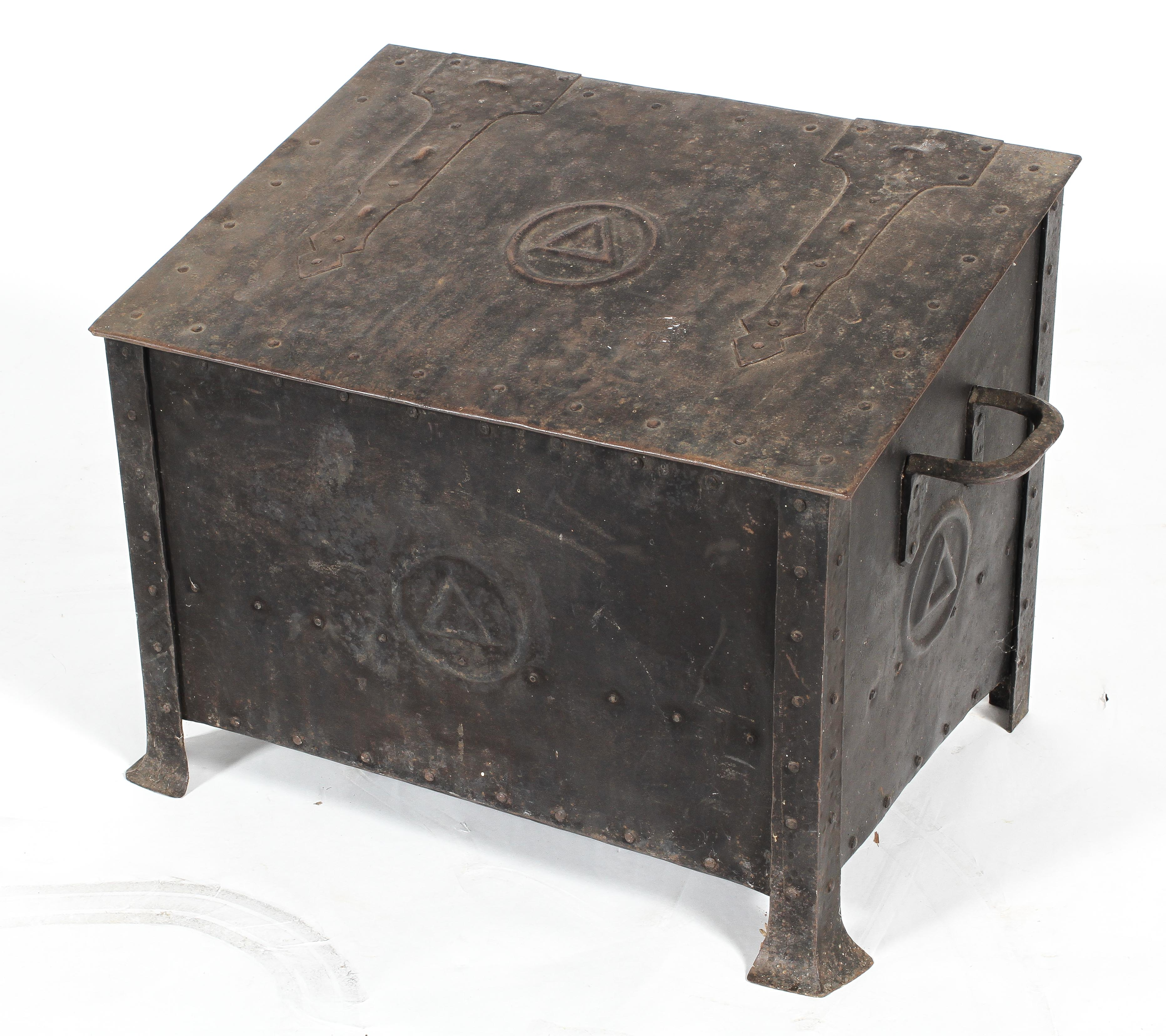 An Arts and Crafts steel coal scuttle, with hinged cover and twin handles,