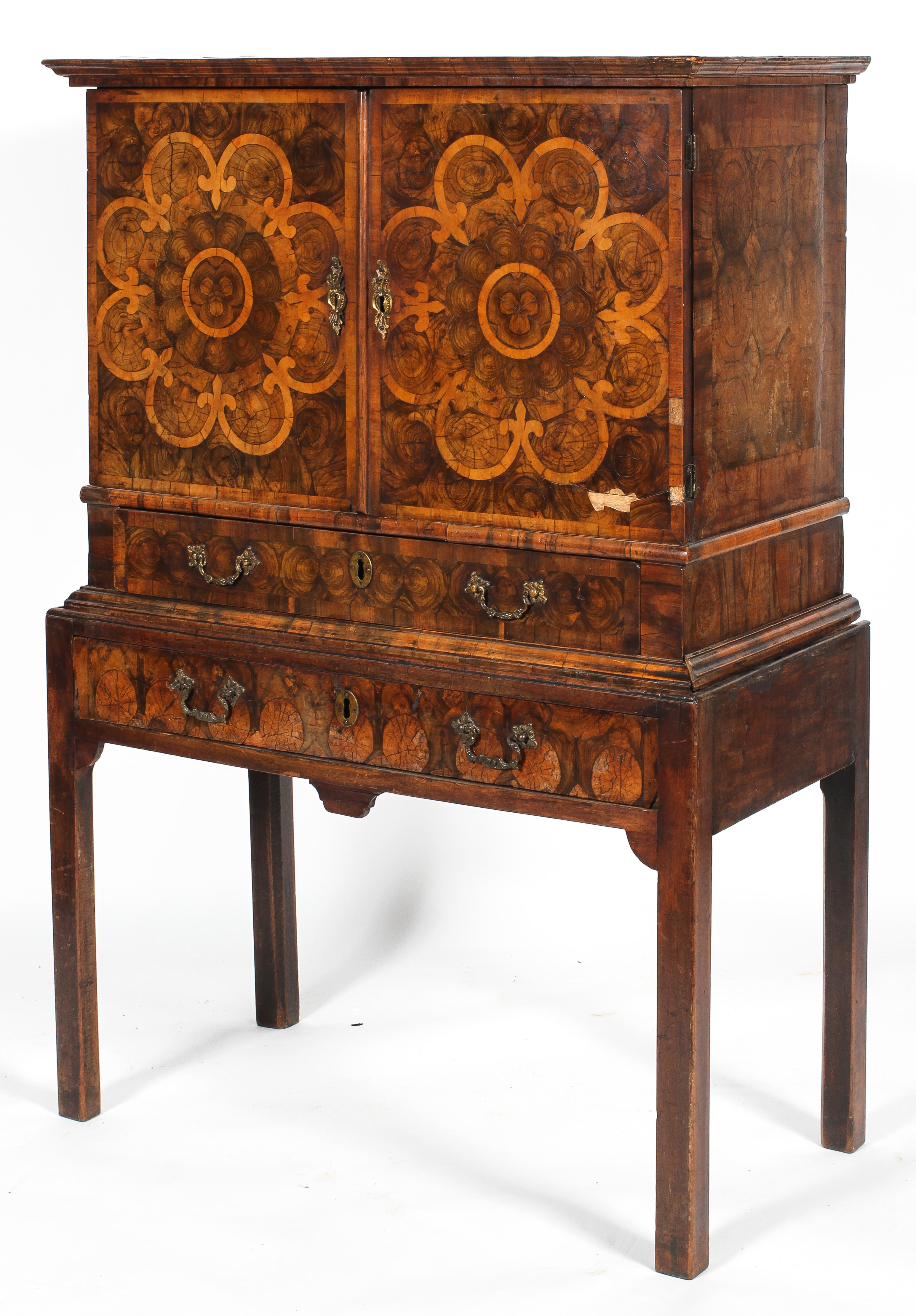 An oyster veneered cabinet on stand, 17th century style but later in date,
