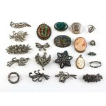 A collection of jewellery to include eighteen brooches of variable designs