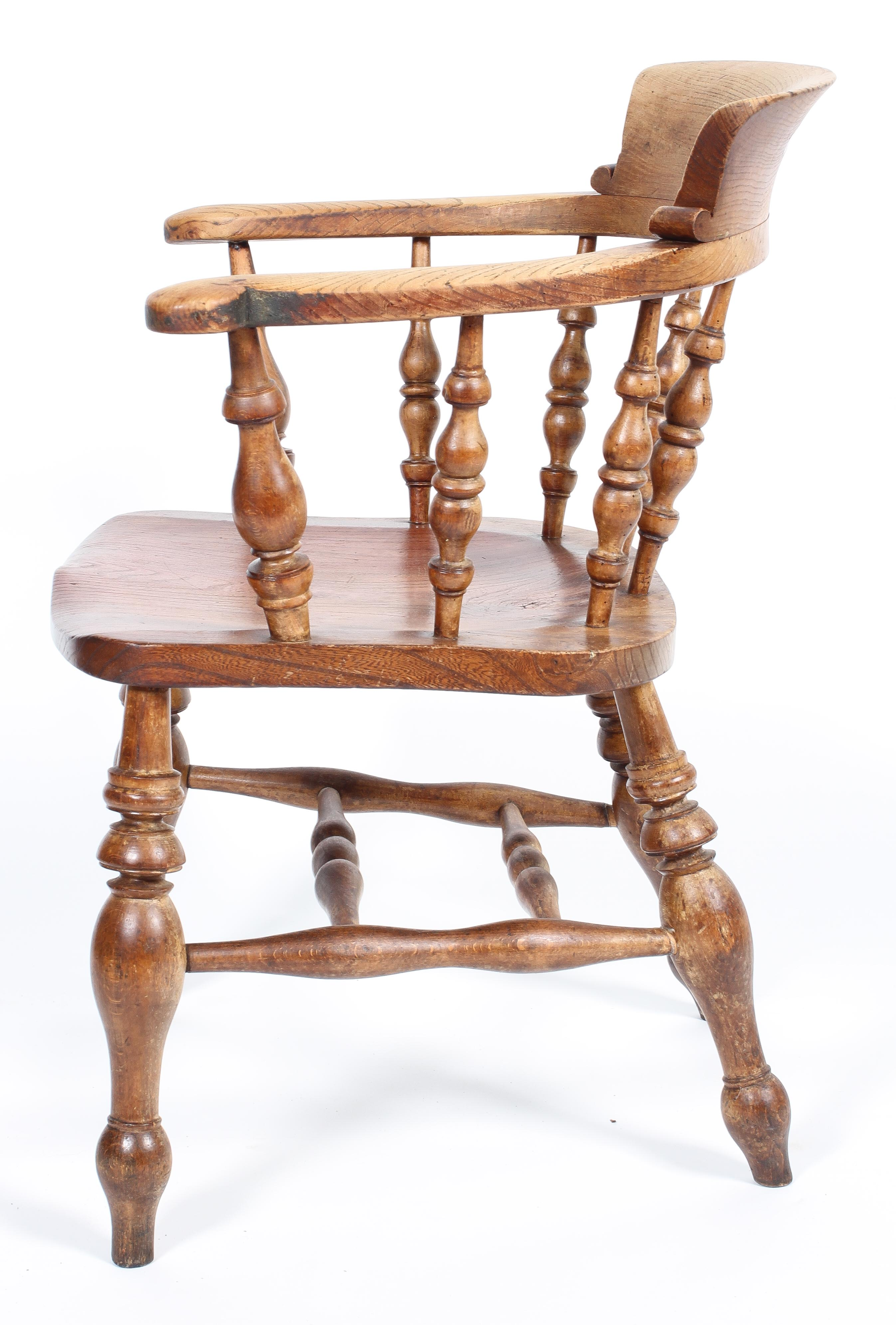 An elm smoker's bow chair, with turned spindles and solid seat, - Image 2 of 2