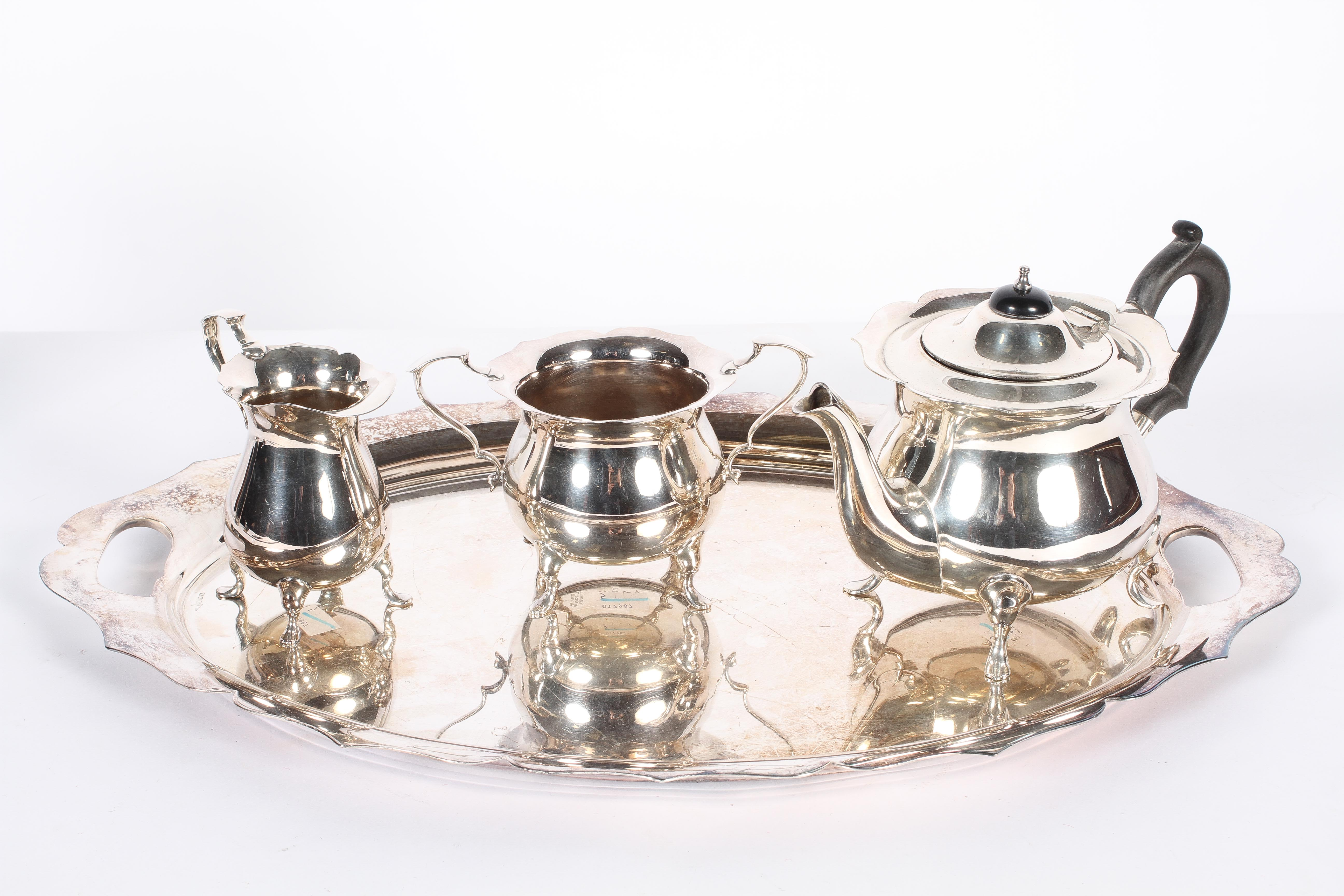 A Walker and Hall EPNS three piece tea set, on tray, stamped marks and numerals,