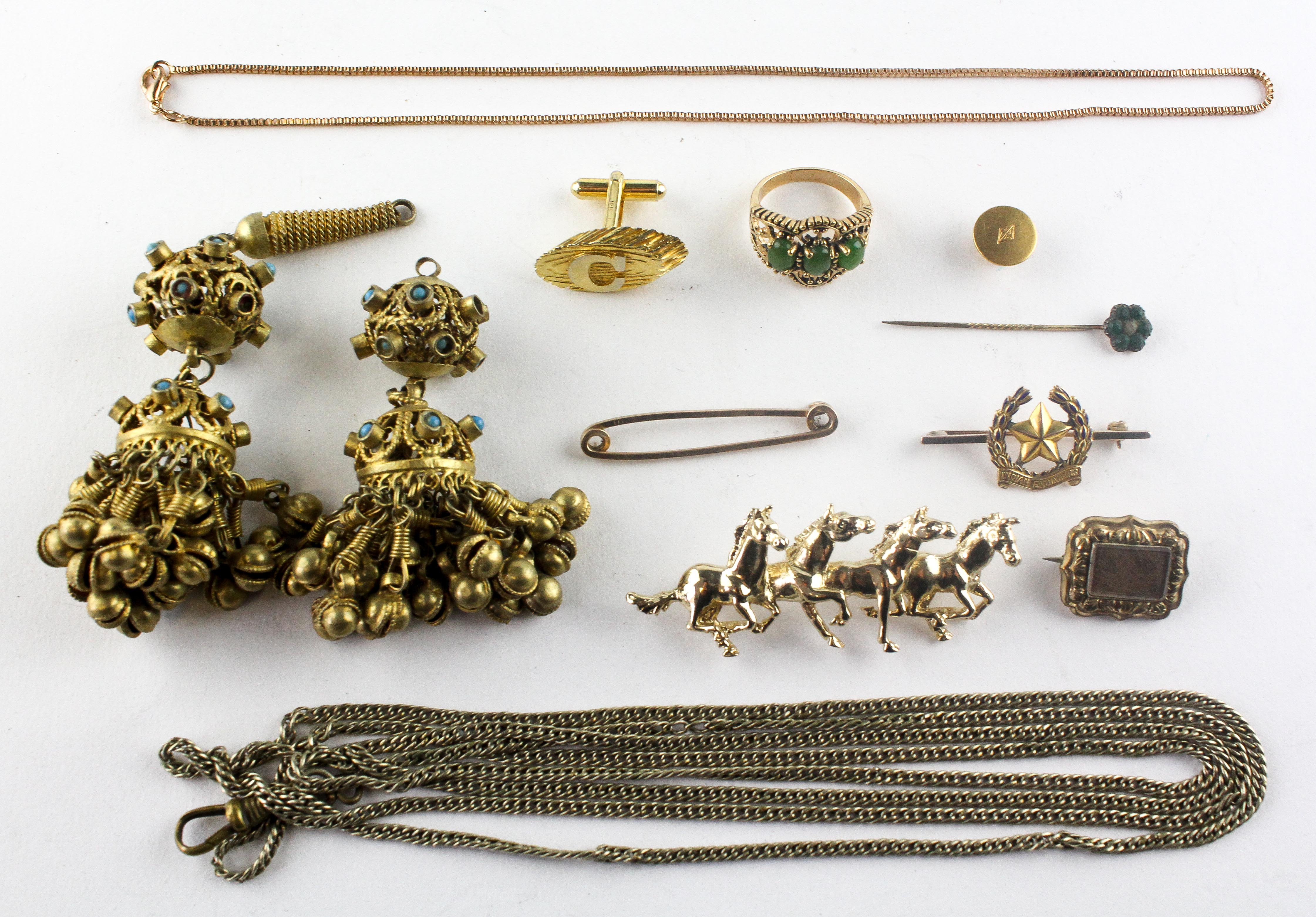 A collection of miscellaneous costume jewellery to include brooches, chains,