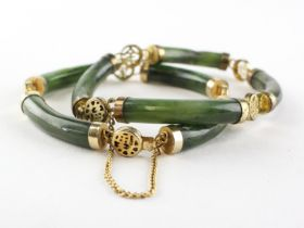 A pair of bracelets of identical design having cylindrical links in the style of nephrite jade
