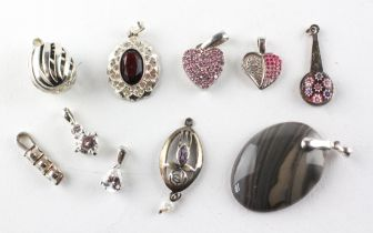 A collection of ten silver pendants of variable designs. Most are stamped 925 for sterling silver.
