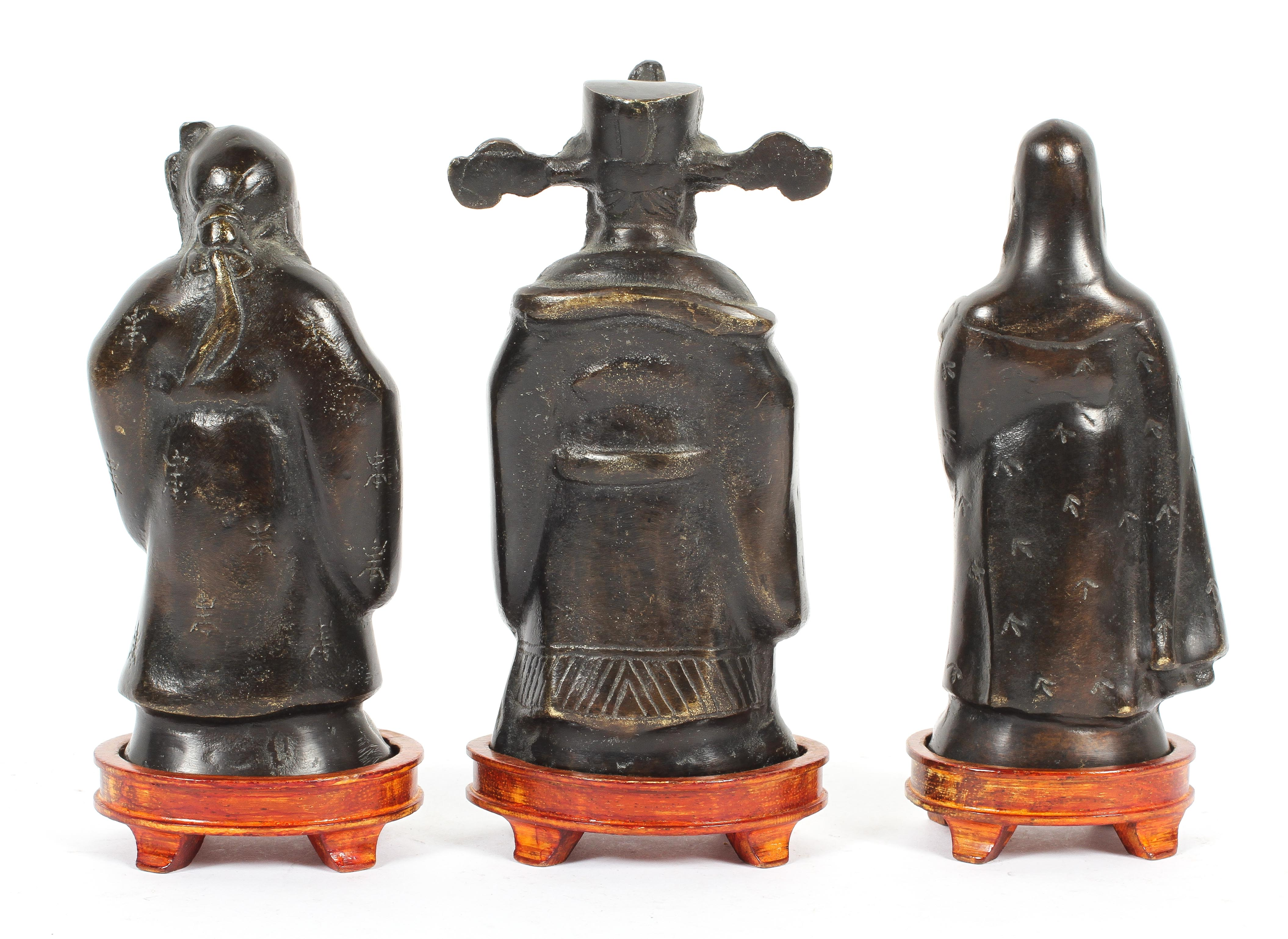 Three Chinese bronze figures of Immortals, on wooden stands, 20th century, - Image 2 of 2