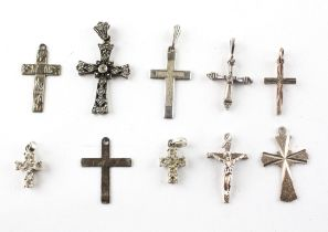 A collection of ten silver cross pendants of variable designs. Most are marked silver and/or 925.