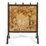 A 19th century oak fire screen with tapestry insert,