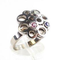 """A white metal gemstone set """"Carousel"""" ring. Hallmarked 18ct gold, Birmingham, 2016. Size L 8."""