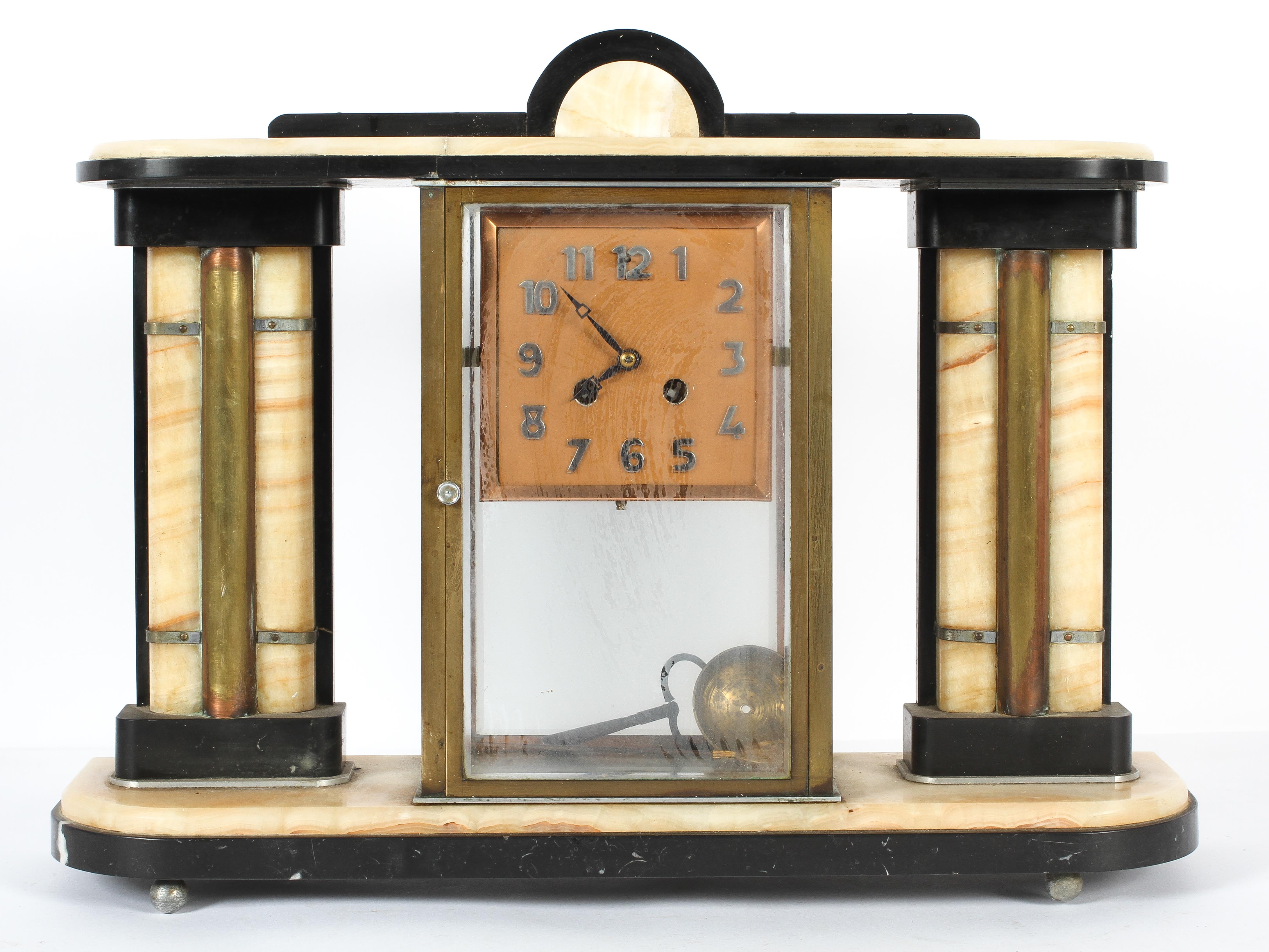 An art deco style clock garniture in alabaster and black slate or marble,