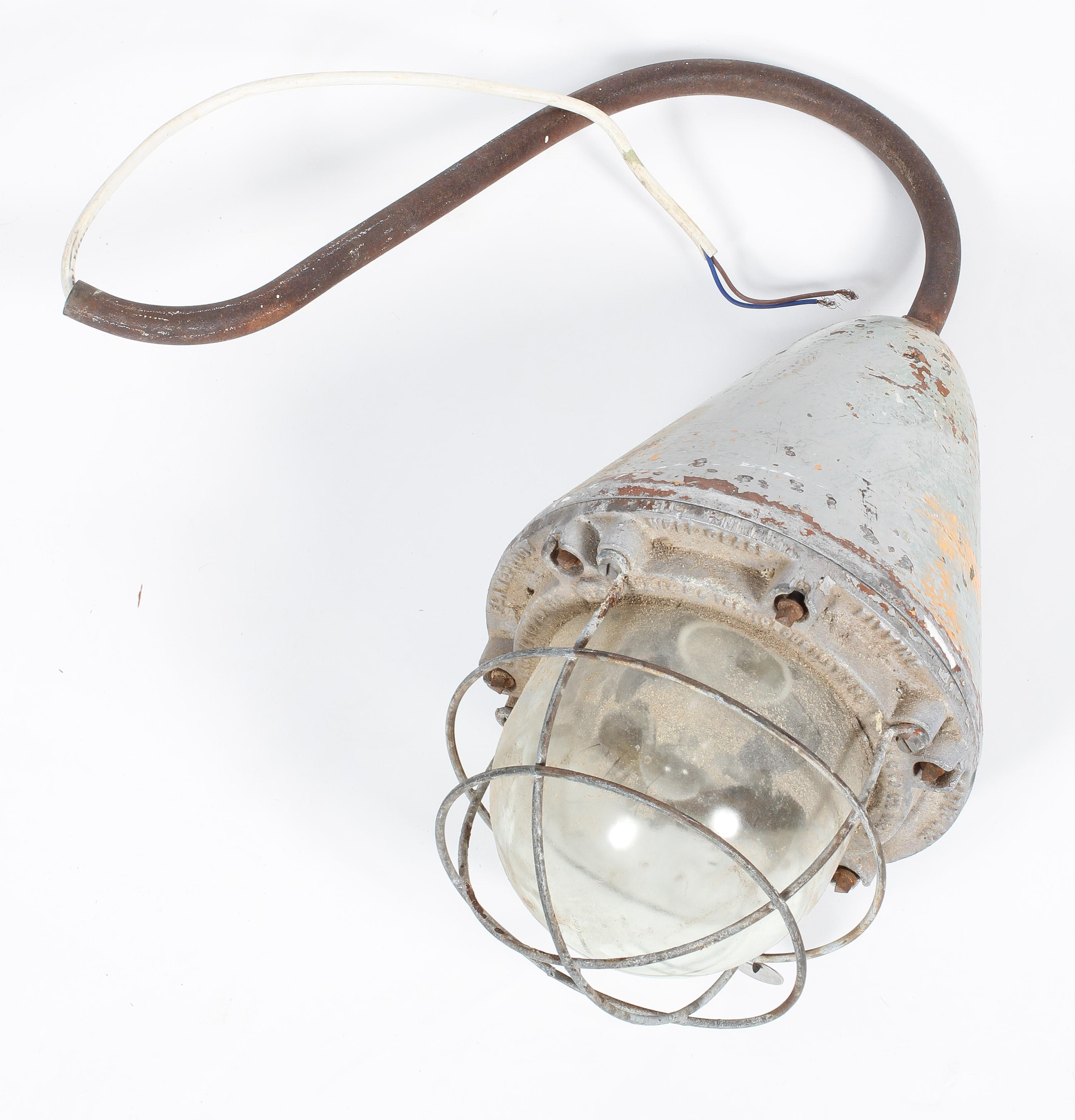 A Hayes & Co 'The Wigan' lamp, with cage surround to the large bulb,
