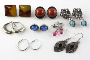 A collection of eight pairs of earrings of variable designs.