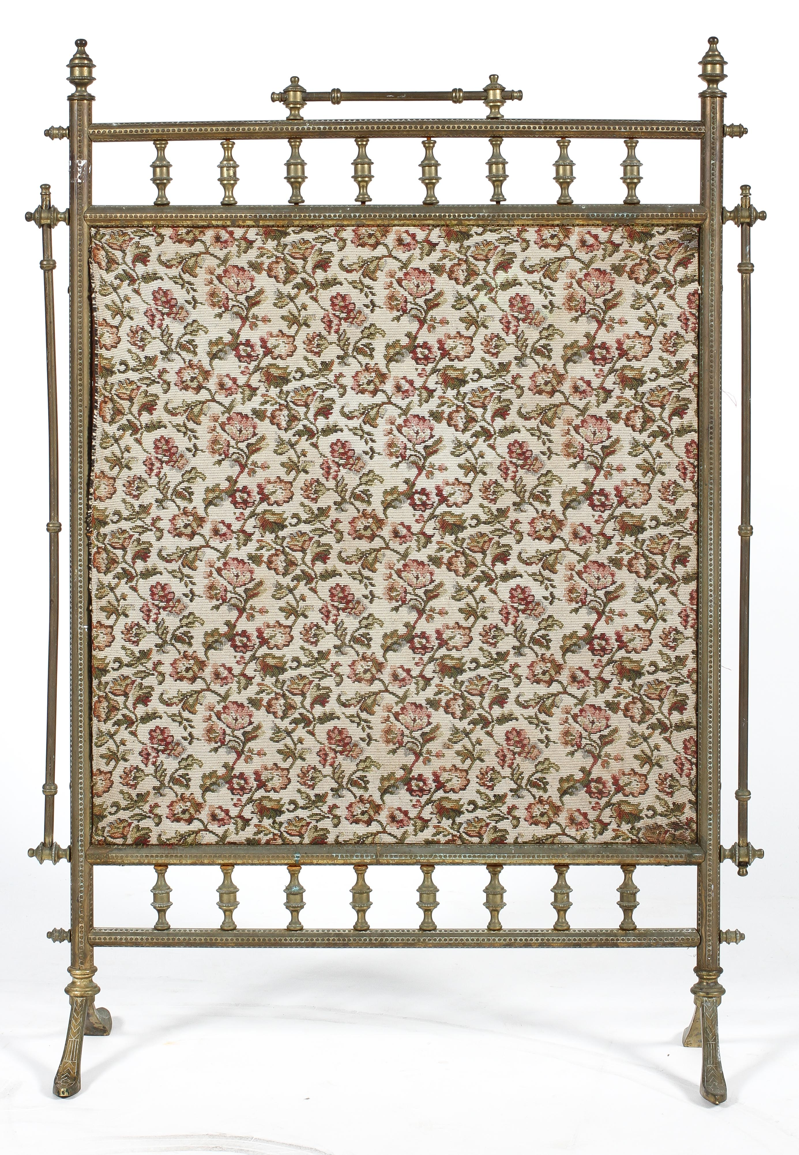 A Victorian brass fire screen, with spindle frame, mounted with tapestry style fabric,