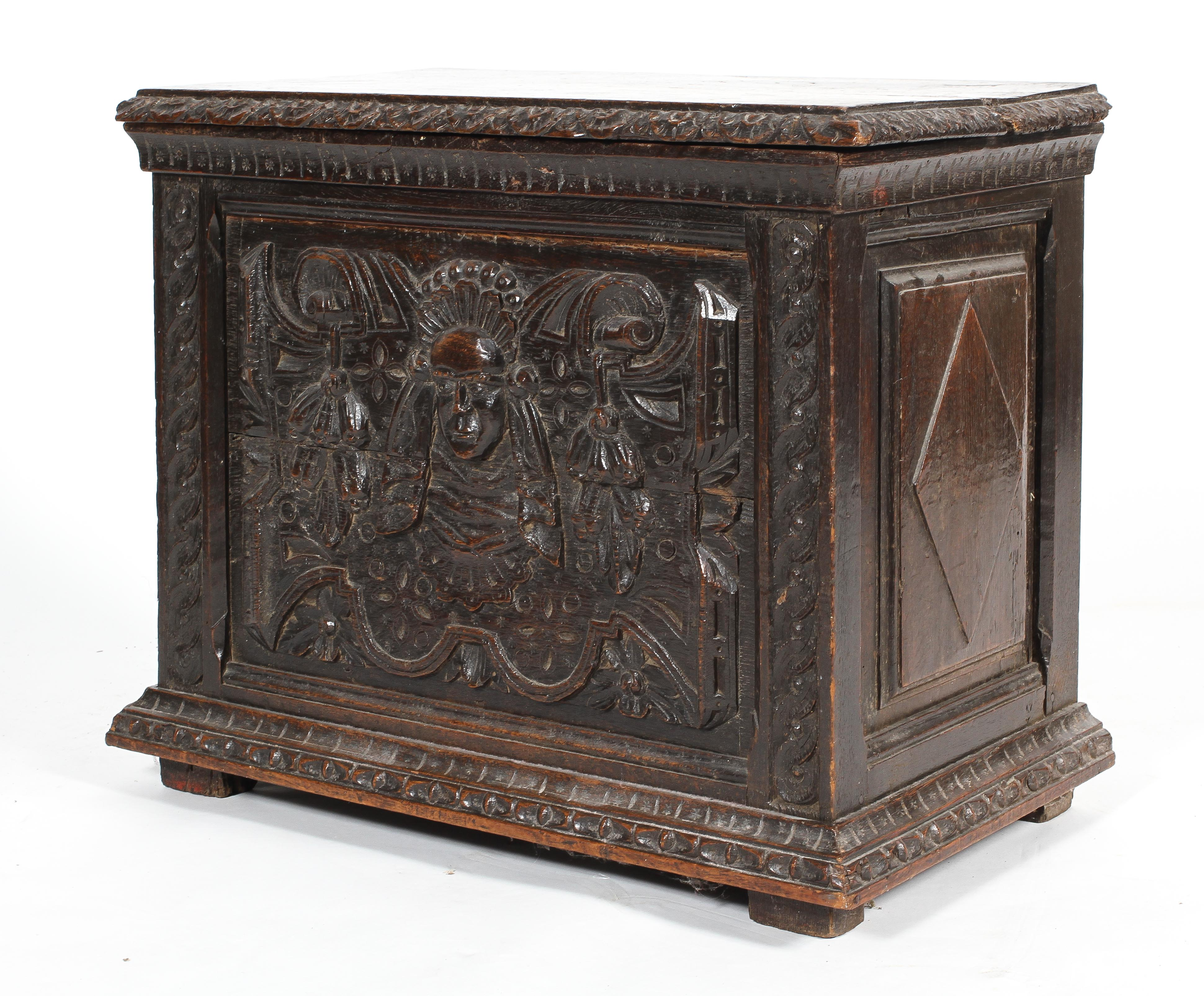 A small oak coffer or box, 17th century or later, with carved foliate rims,