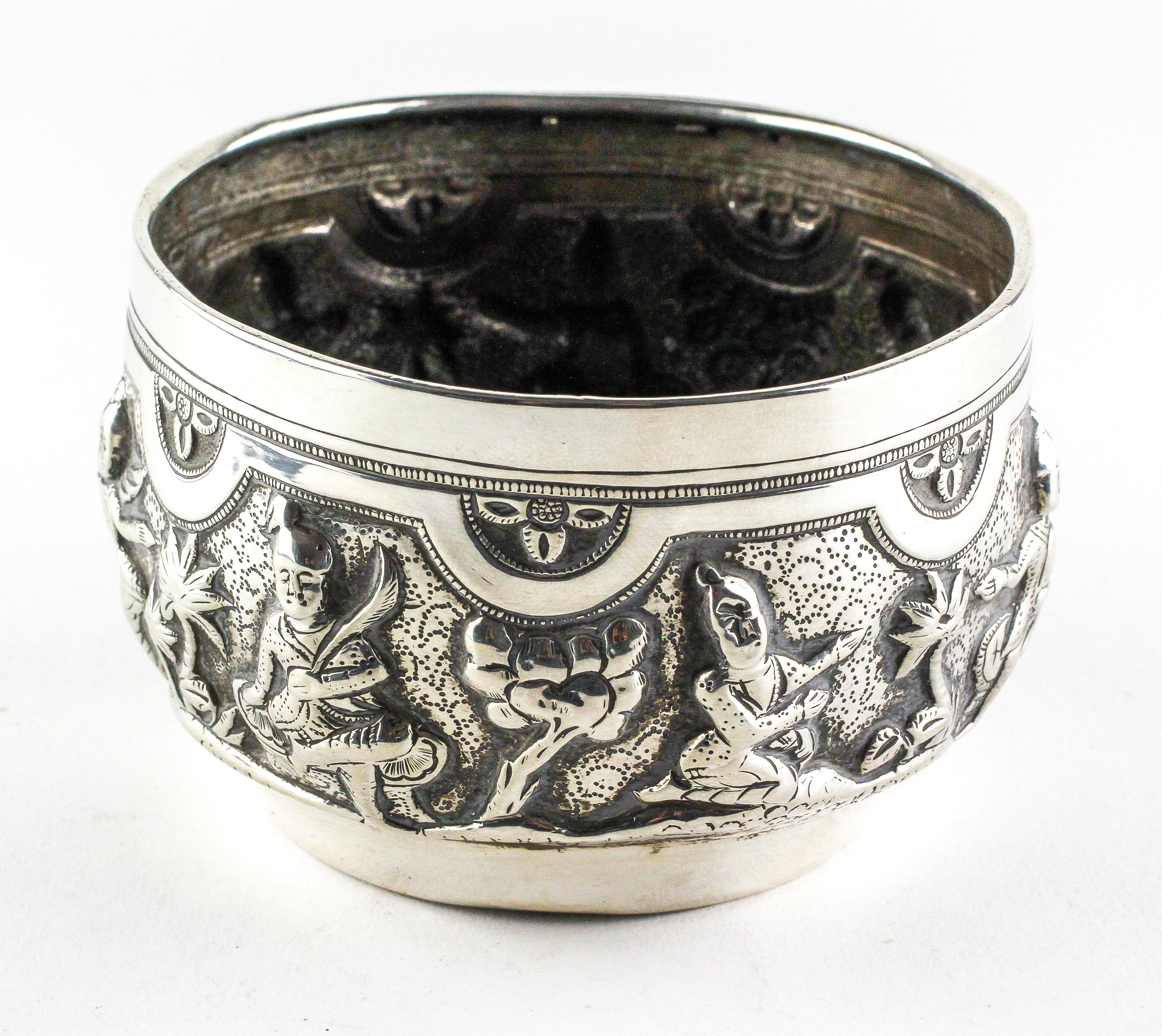 An Indian white metal bowl, late 19th or 20th century, embossed with figures and plants, - Image 2 of 2