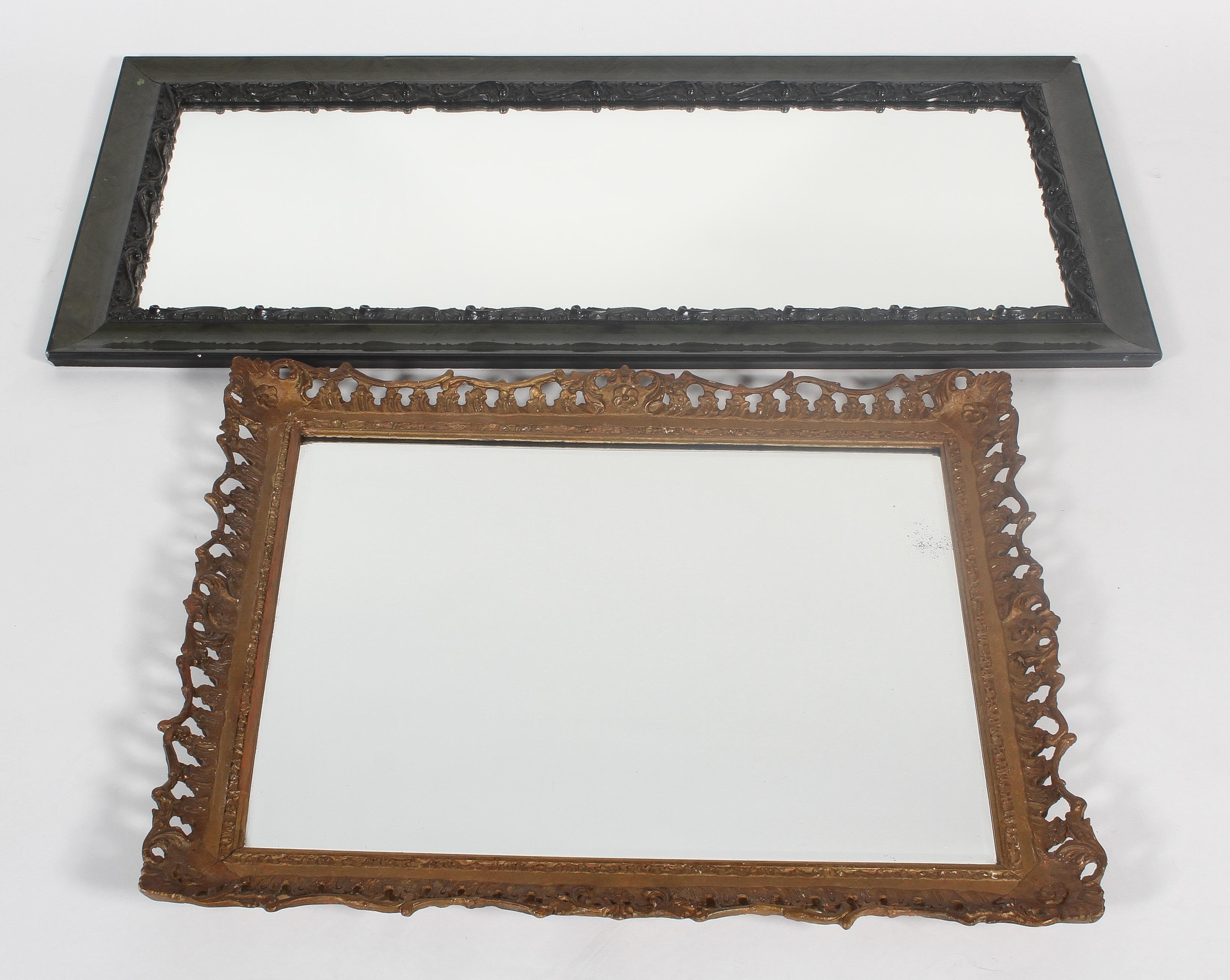 A giltwood and gesso mirror frame, together with an ebonised and carved wood dressing mirror,