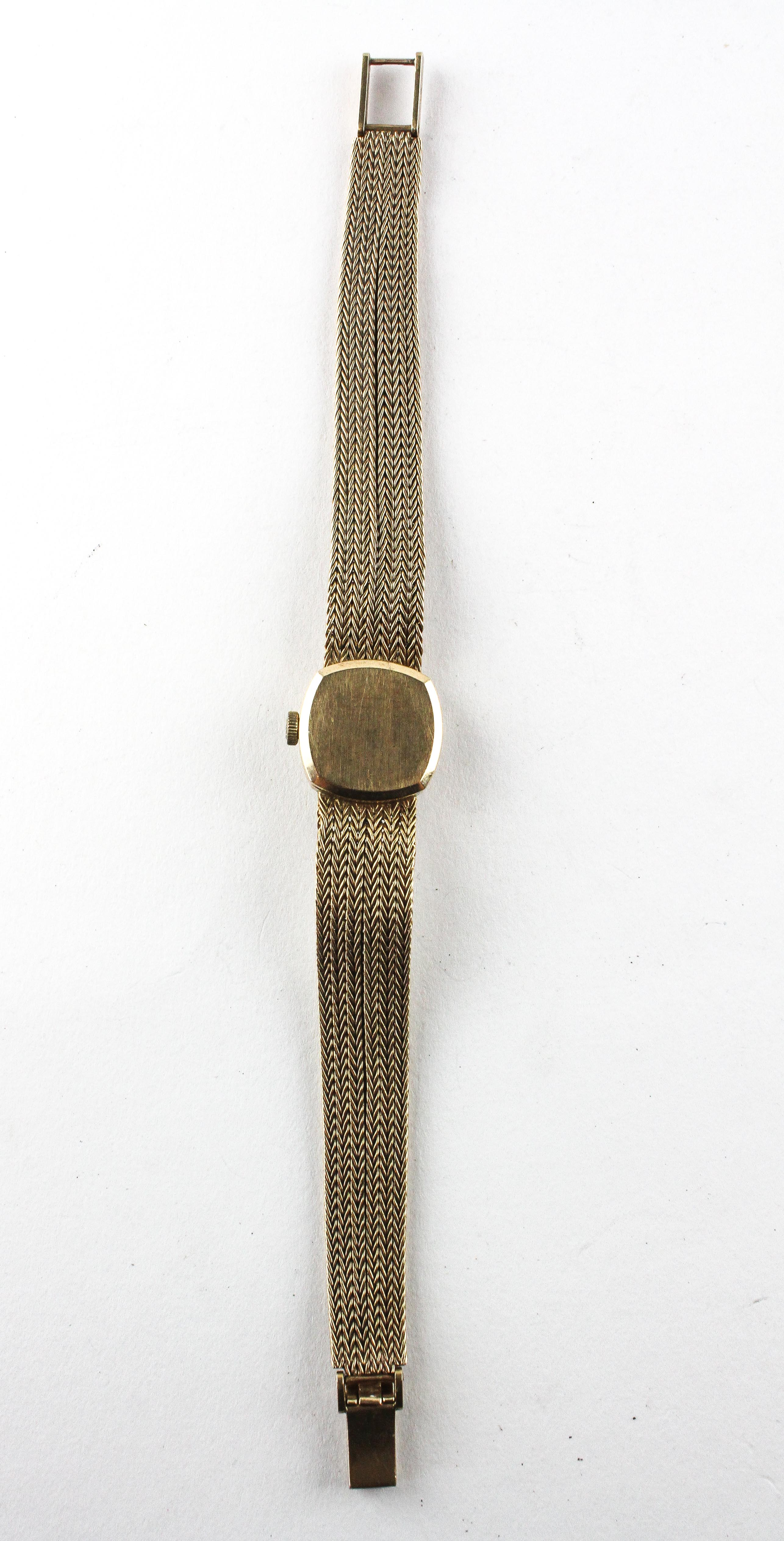 A yellow gold omega wristwatch. Circular gold dial with baton markings. - Image 3 of 4