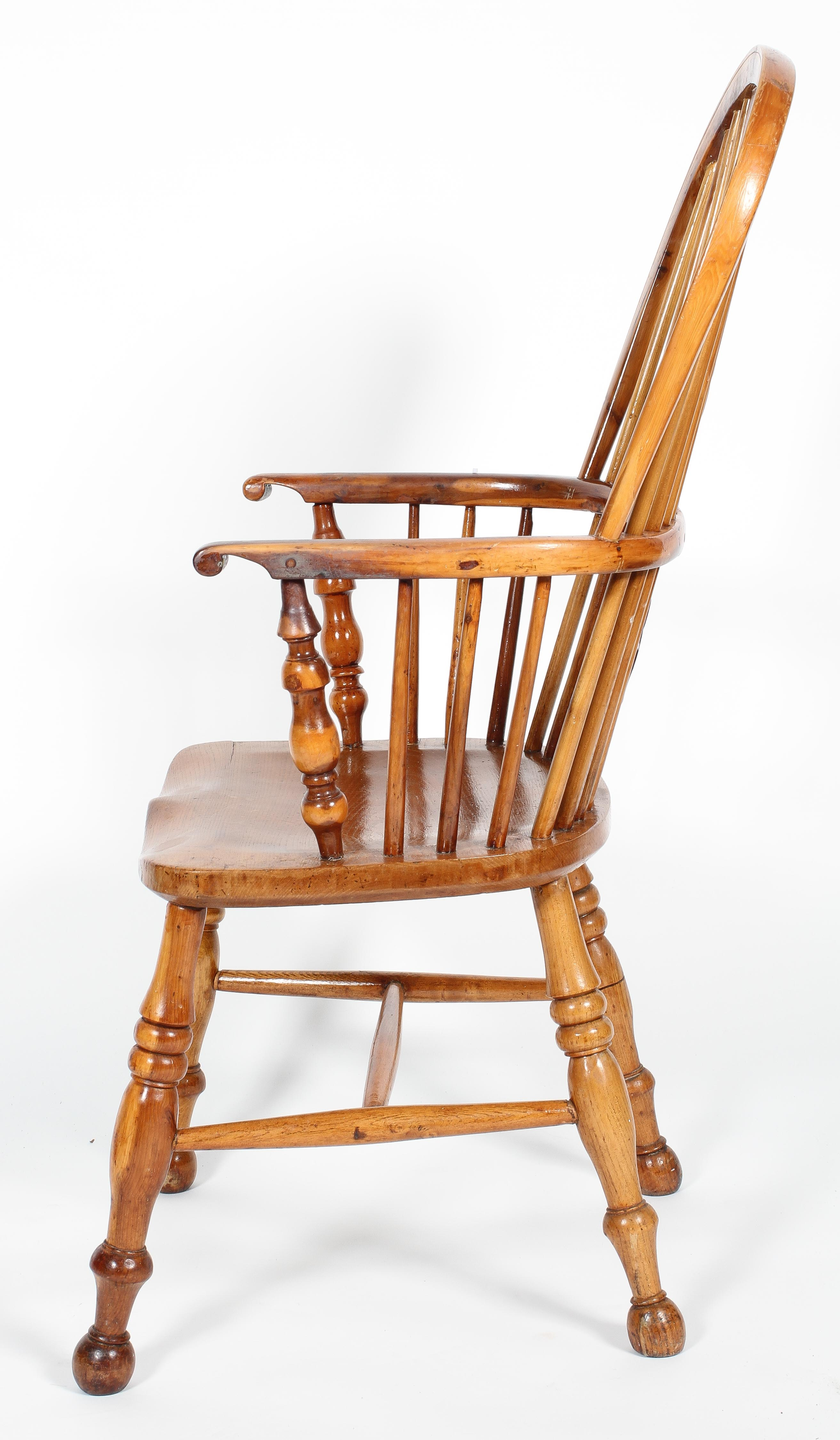 An oak and yew Windsor chair, with pierced scroll splat and baluster arm supports, - Image 2 of 2