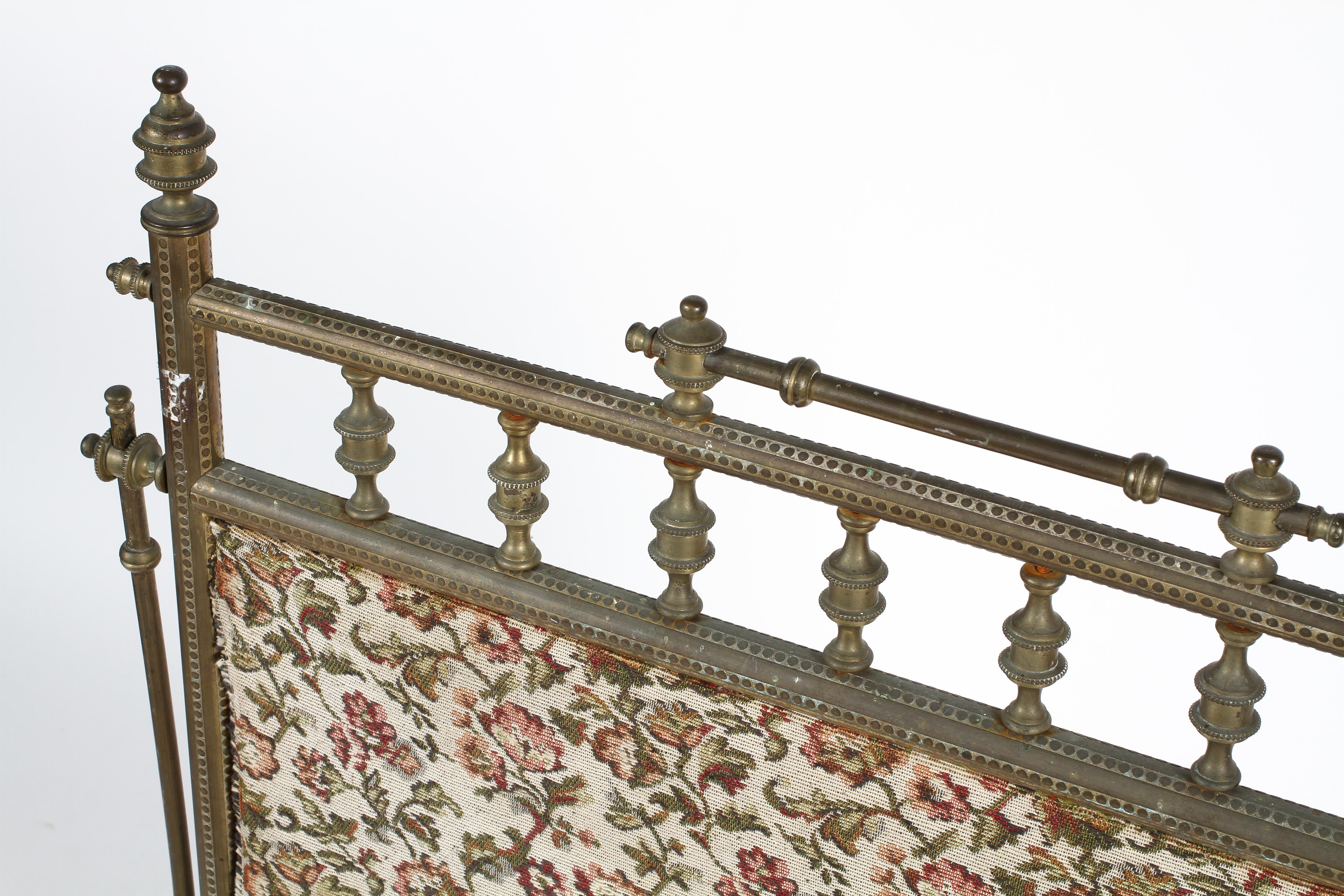A Victorian brass fire screen, with spindle frame, mounted with tapestry style fabric, - Image 2 of 2