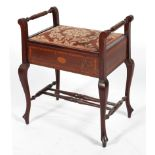 An Edwardian mahogany and inlaid piano stool,