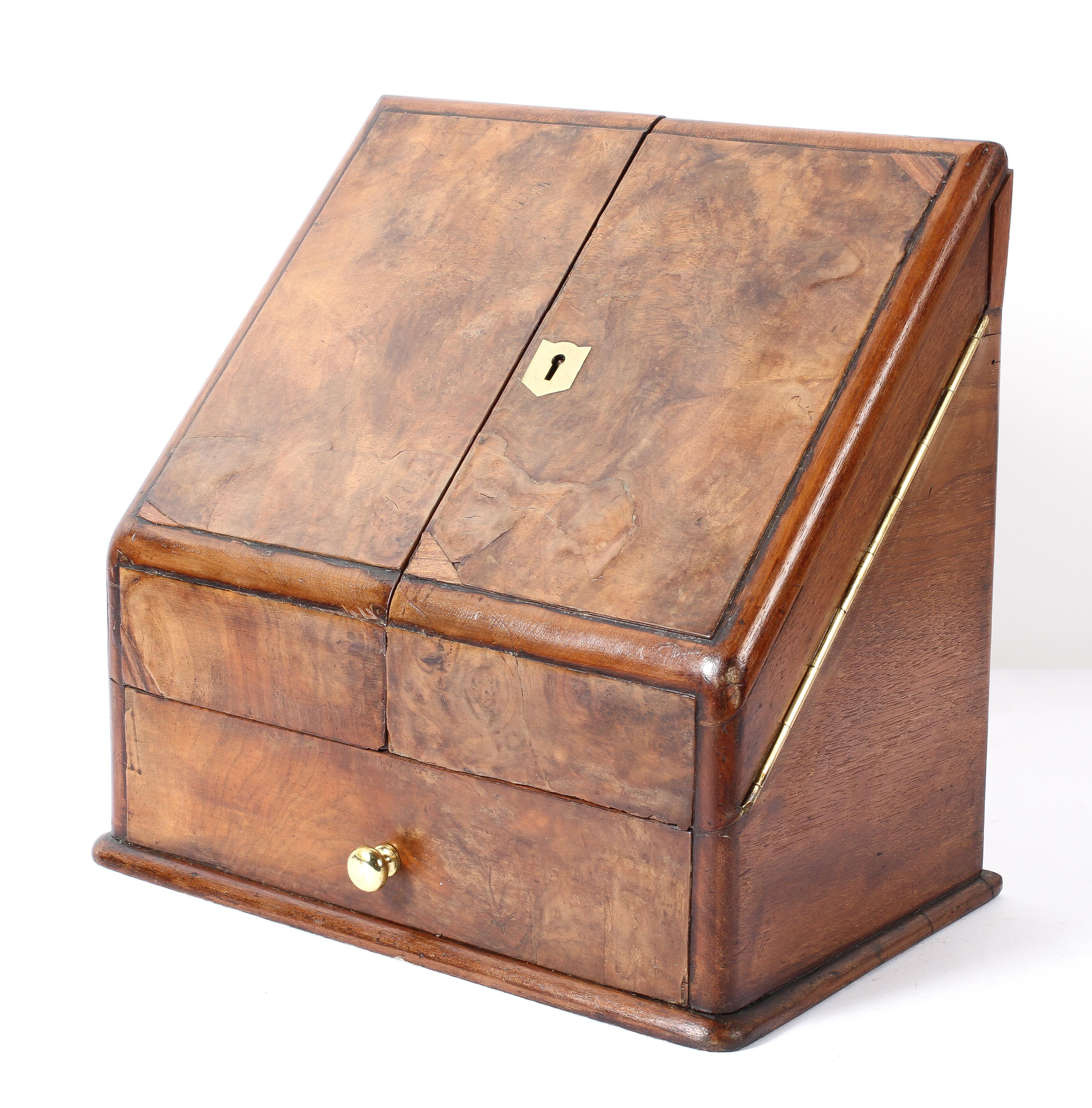 An Edwardian walnut stationery cabinet,