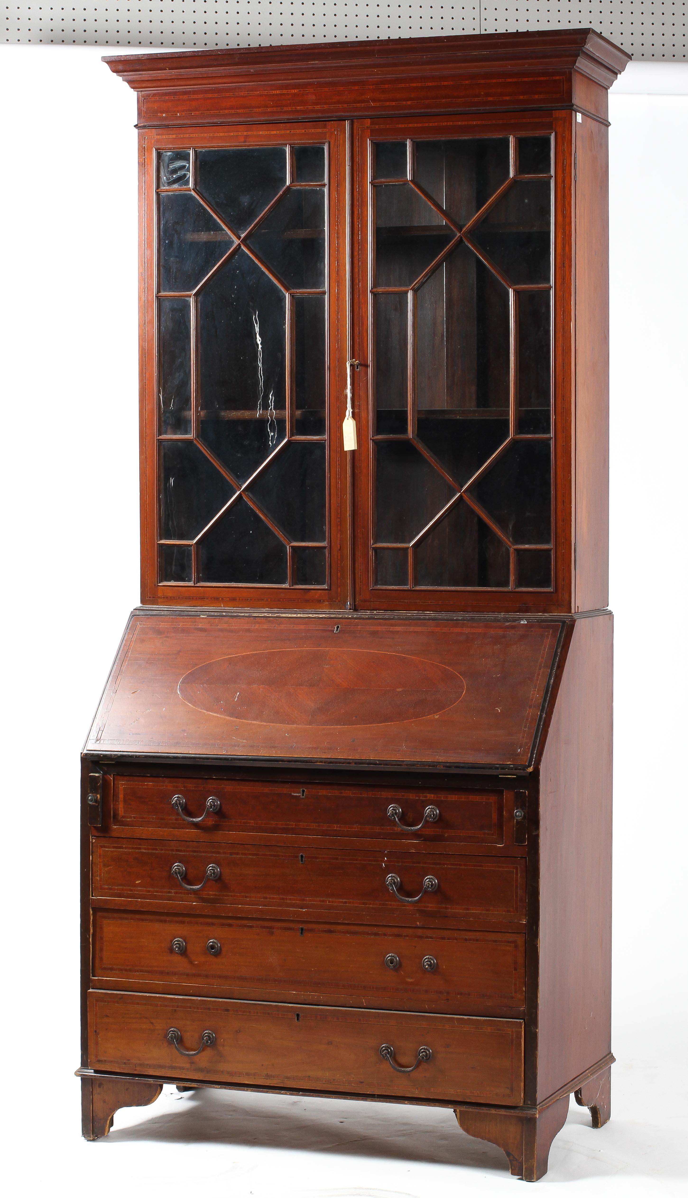 A Georgian style mahogany and inlaid bureau bookcase,