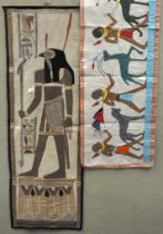 Two Egyptian cotton figural wall hangings,