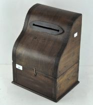 A wooden tabletop post box,