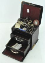A leather cased jewellery box, containing a selection of necklaces,