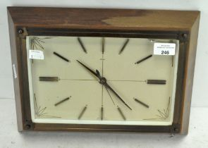 A vintage Metamec wall clock, of rectangular form, the dial with batons denoting hours,