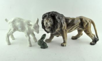 A group of three ceramic animals, to include a Melba ware lion,