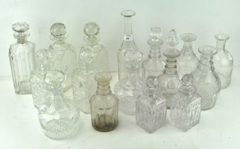 A quantity of glass decanter bottles, of assorted shapes and sizes,