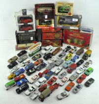 A collection of Die cast model vehicles, including examples by Matchbox, Burago, Corgi and others,