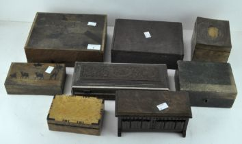 A selection of wooden boxes of varying designs, including carved inlaid example,