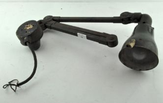 A vintage industrial anglepoise style lamp with four rotating joints,