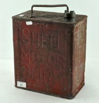 A vintage red painted Shell Motor Spirit fuel can,