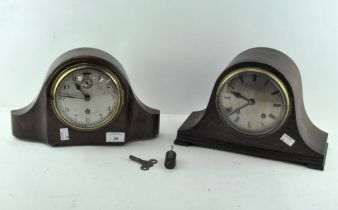 Two mantle clocks, one oak cased, the dial with Roman numerals denoting hours,