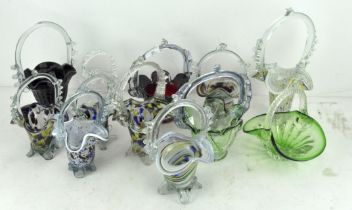 A collection of coloured Art glass single handled basket dishes,