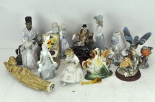 A collection of assorted ceramic figures and others,