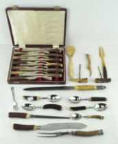 A collection of antler handled cutlery, including a silver-mounted carving set,