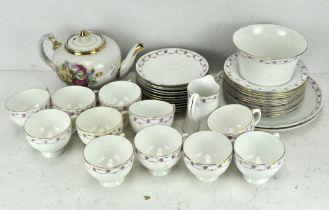 An extensive porcelain tea set, floral border on a white ground,