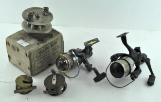 A group of five fishing reels, to include an Orlando minor reel,