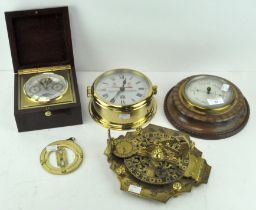 An aneroid barometer by Negretti & Zambra London, in a wooden mount,