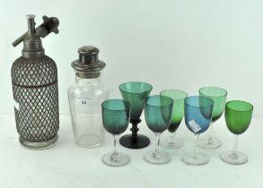 A vintage lattice wrapped glass soda syphon by 'Aerators Ltd London',