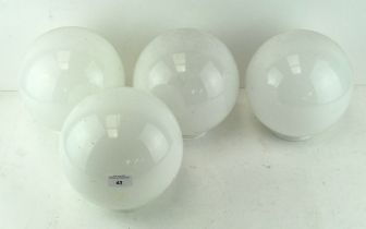 A set of four glass lamp shades, of spherical form,
